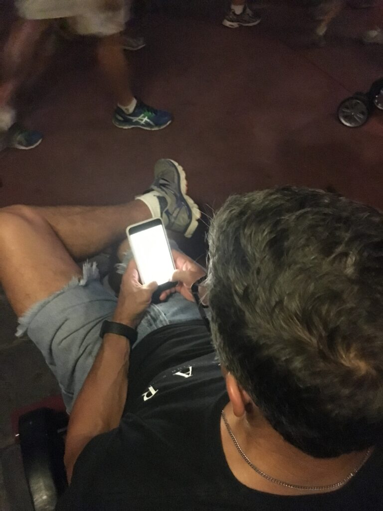 man typing on iPhone