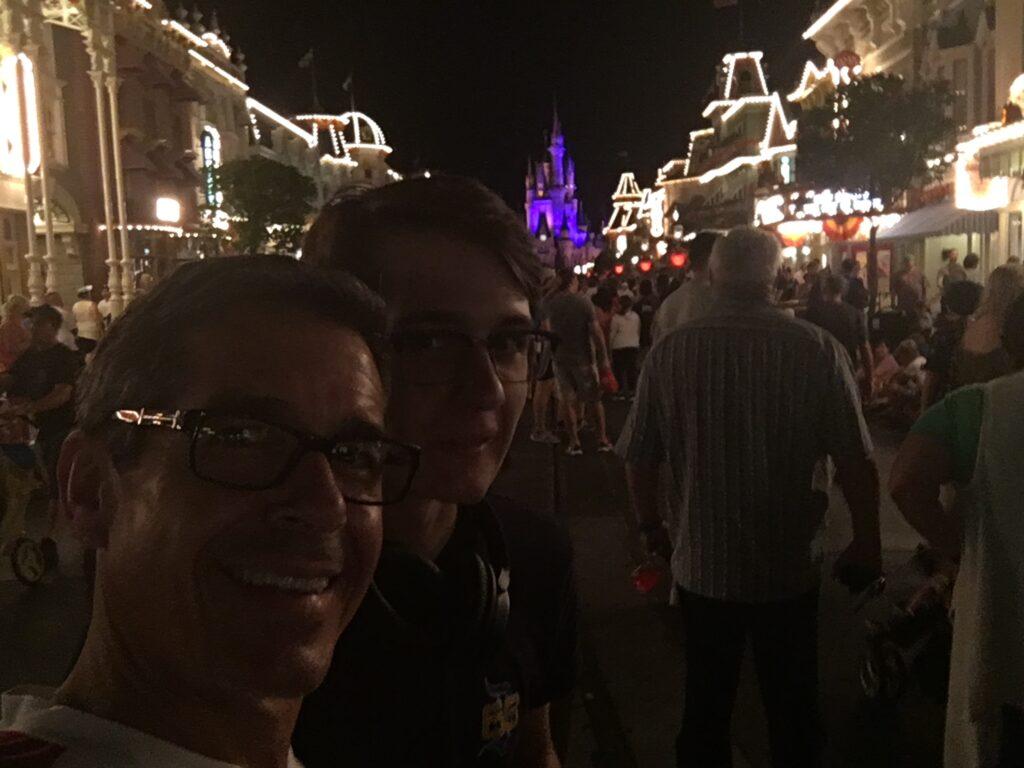 crowded main Disney Main Street at night