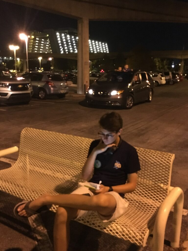 teen sitting on bench at Disney's Contemporary Resort