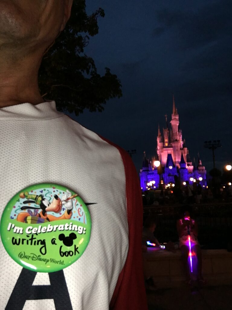 Disney button on Main Street at night