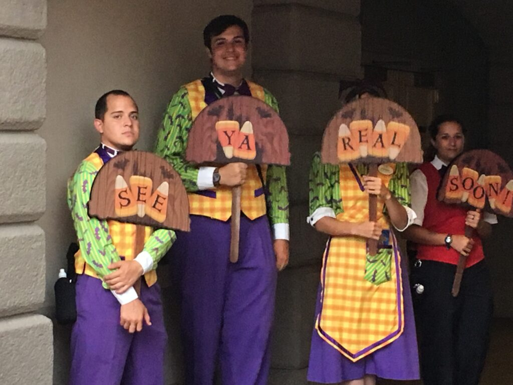 Four Cast Members in Halloween themed Cast Member costumes