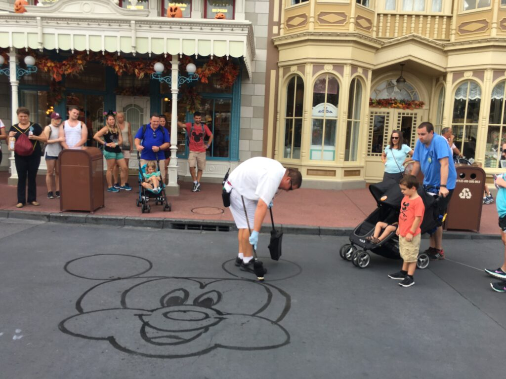 Disney Custodial Cast Member drawing Mickey with water