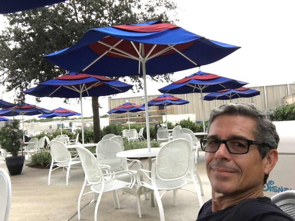 Man sitting at Disney University's outdoor break area
