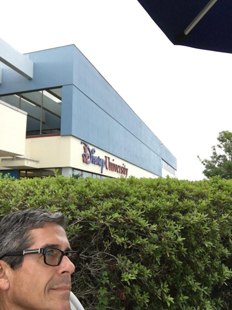 Man sitting outside Disney University