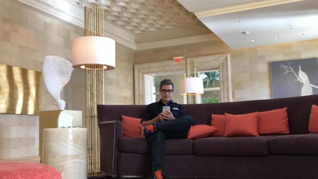 Disney author Jeff Noel writing in Resort lobby