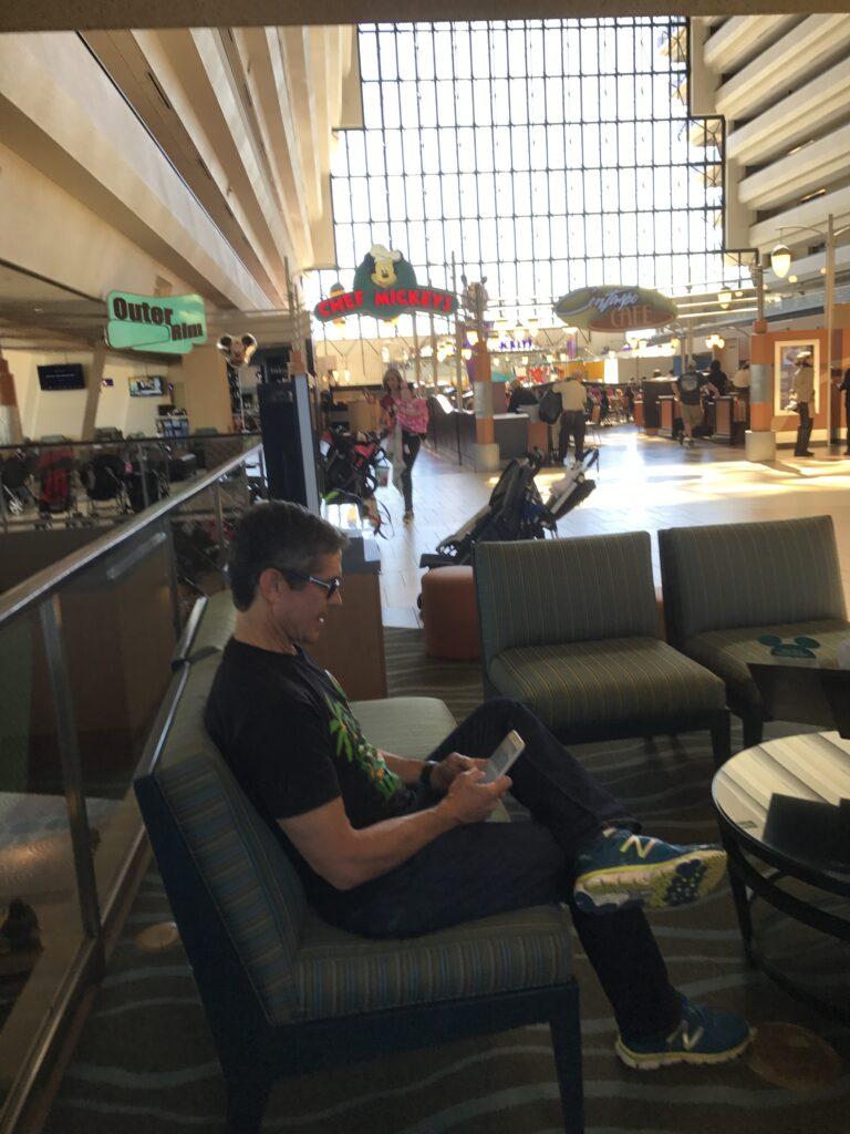 Disney speaker Jeff Noel writing on iPhone at Disney